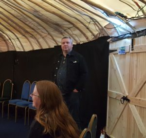 man in yurt